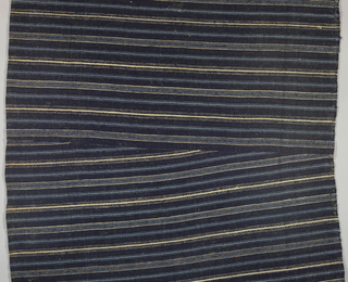 Fragment of a skirt panel in stripes of dark blue, light blue and white.