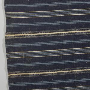 Fragment of a skirt panel in stripes of dark blue, light blue and white.