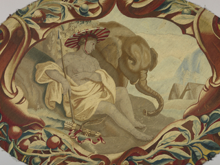 """Oval fragment representing """"Africa"""" shows a draped female figure with a striped hat and spear. Bow and quiver rests near her legs. Just beyond her is an elephant, and in the far background are tent-like structures and palm trees. In shades of red, blue, brown and off-white. Probably a detail from a table cover."""
