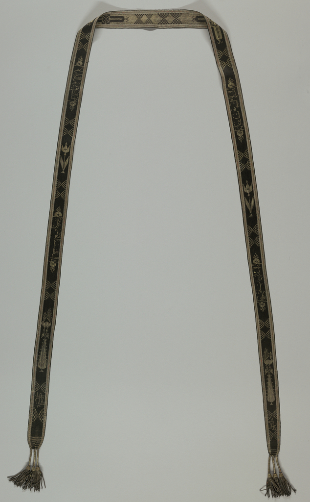 Long, narrow band with Arabic inscription amid geometric forms worked in silver and black; a small silver tassel at each end.