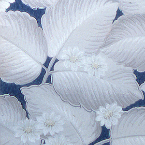 Beige leaves with off-white flowers with a blue background on a beige ground.