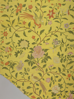 Yellow ground with polychrome tempera design. Central serpentine stem with curving branches with many flowers on each side. Birds of brilliant plumage perched on branches.