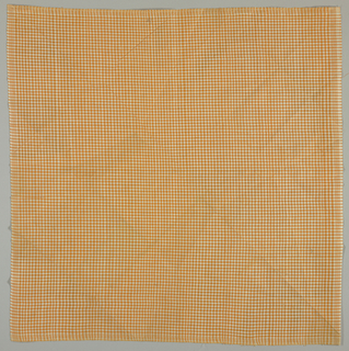 Unhemmed square of orange and white gingham.