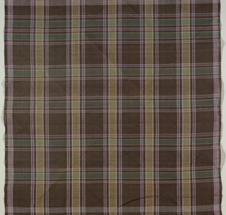 Large check gingham in white, dark green, dark purple and dark brown.