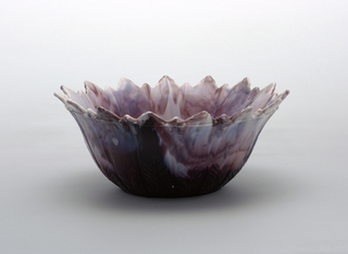 Light purple and white glass bowl