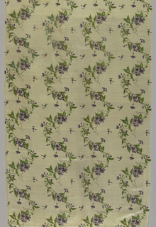 Three lengths of a vertically serpentining flowering vine pattern in lavender and green. They were originally part of the skirt of a dress.