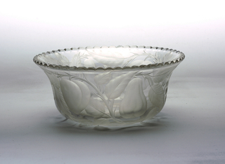 Clear glass bowl with scalloped edge.  Engraved and etched fruit decoration