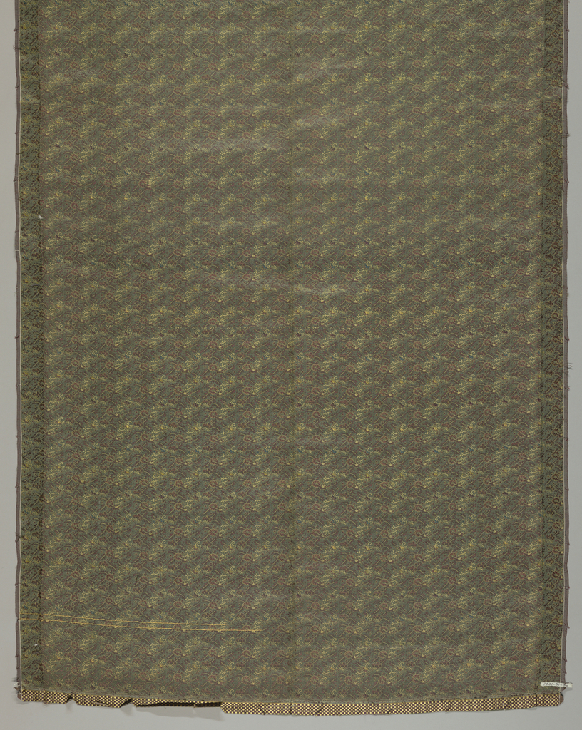 Panel of obi fabric with a gray-green ground has a small vine pattern in brown, yellow and blue-gray.