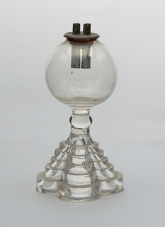 "Wells of blown glass on stepped (pressed) bases shaped in four lobes; fitted with two tubes in tin plates (marked ""PATENT"") with original cork packing."