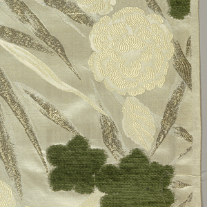 Large olive-green chenille flowers on cream flowers and silver leaves. Design is an off-set.