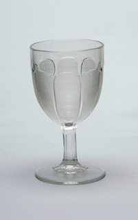 Goblet decorated with eight elongated scallops infilled with hatching