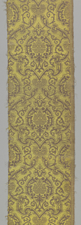 Scroll and pomegranate pattern in yellow and mauve.