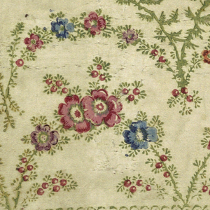 Ivory ground with a border design printed in green, red, pink, purple, orange and blue. Arches of feathery foliage and small round blossoms, berries and buds.
