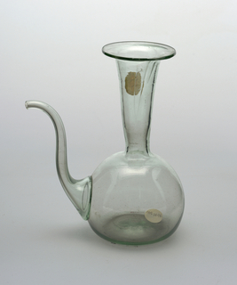 Clear glass spouted vessel with a light green tint.