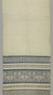 Perugia-type towel with bands of blue patterning at each end of a white field. Pattern bands, same at both ends starting from the bottom, have birds separated by trees and confronted lions separated by guard borders of arrow heads.