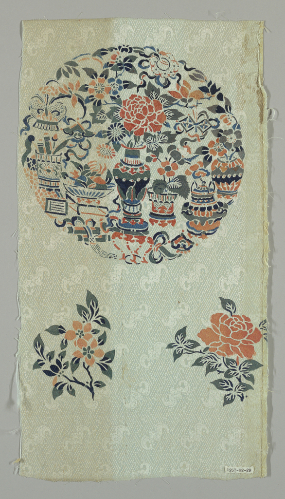 Oyster colored tabby with twill-effect  ground pattern of frets and bats; stenciled in bright colors with large floral medallion and two flower sprays.