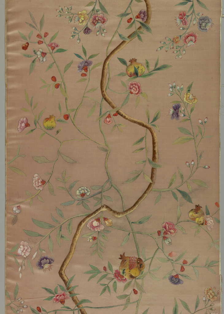 Flowering branches with pomegranates painted in polychrome. A curved stem runs through the center.