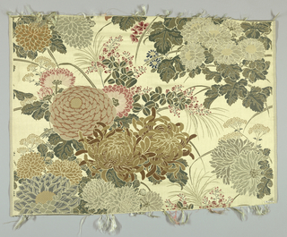 Cream satin ground with large-scale design of several varieties of chrysanthemums and other smaller flowers brocaded in polychrome silks. Extra green weft forms the foliage. Both selvages present.