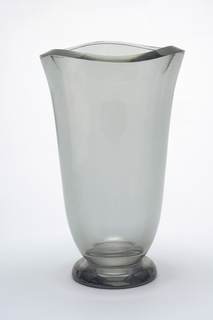 Housing recommended Slight hint of grey glass.  Vase flares open to irregular shape.