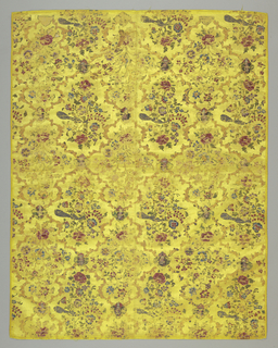 Persian style yellow silk taffeta ground painted in tempera, in multicolor cartouches framed by diagonally intersecting blends enclosing in staggered rows two floral compositions, one containing a peacock, intersection gruadrefoils—framing female head.