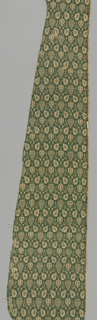 Grape and pomegranite motif in green and tan. Selvage at one side