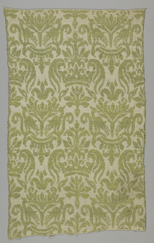 Large allover design with French royal crown and heraldic lilies in light green on off-white ground.