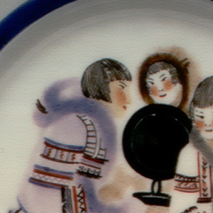 Circular, with blue border around inside rim; in center a scene of three eskimo people, dog, and radio receiver