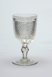 Small faceted diamond shapes on goblet.