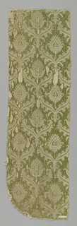 Fragments of cream-colored cotton brocaded with green and gold metallic thread. Design shows pomegranate.