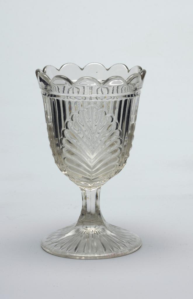 Leaf pattern on goblet, scalloped edge on glass rim