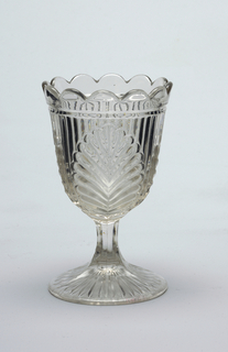 Leaf pattern on goblet, scalloped edge on glass rim