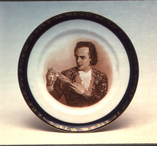 Circular, with image of man holding glass slipper in center, surrounded by blue border with gilded ribbon motif