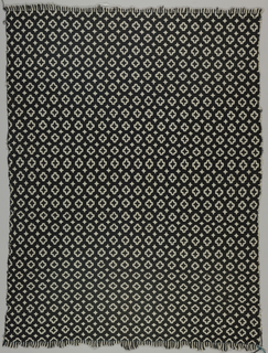 Panel of double cloth, wool, in black and white in all-over geometric pattern of dots and stars