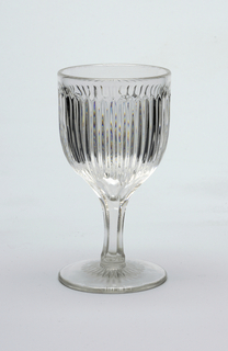 Series of vertical ridges on goblet.