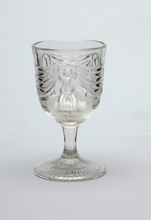 Swag and tassel pattern on goblet.
