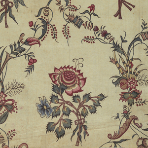 Diamond lattice enclosing floral forms. Horizontal line at bottom. Faint pencil line at right where fabric was cut.