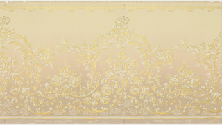 Repeating design of large medallions composed of scrolls. Asymmetrical arrangement in Rococo style. Narrow band of scrolling motfs along top edge. Background shades from light at the top to darker at the bottom. Printed in white and metallic gold on an off-white or tan ground.