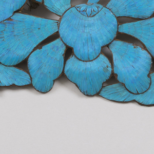 Kingfisher plaque of conventional fruit or leaf design in openwork. Silk covered wire on back for attachment to Manchu head-dress.
