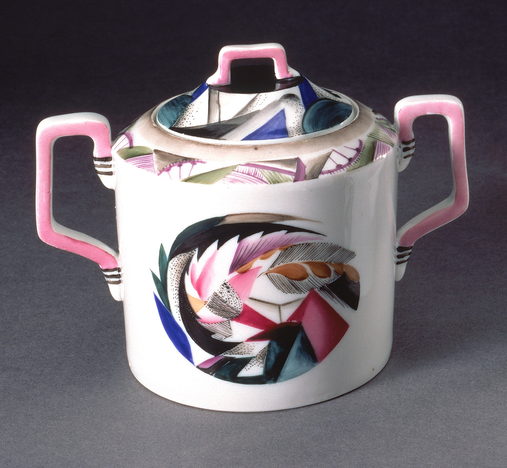 Body cylindrical in form, two square section handles; painted ornament consisting of stylized and abstracted agricultural motifs and industrial tools.