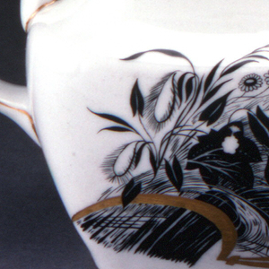 Body with flaring sides, slightly squared off, long curved spout, high loop handle, lid with vine form handle; painted on one side with stylized cornucopia and flower blossoms and on the other in black and gilding; gilded rim around top edge and base of body, around outer edge and handle of lid
