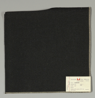 Plain weave with doubled warps and wefts in black. Weave structure adds a subtle surface texture. Number 275.