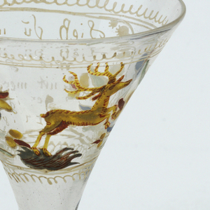 Clear glass globlet, vessel has wide flaring opening (martini glass).  Large footed stem.  Painted stag central figure.