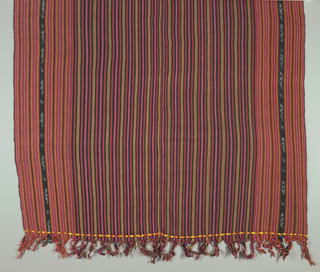 Panel with alternating black, red, yellow, purple, pink, green, and white stripes with ikat stripes near the edges.