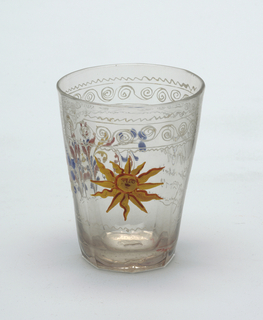 Clear glass beaker with painted decoration.  Slight gray cast to glass.  Sun central figure.