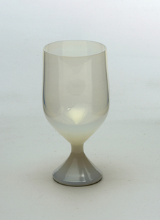 Opalescent glass with bell-shaped cup and foot.