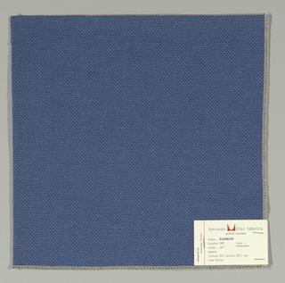 Plain weave with doubled warps and wefts in blue. Weave structure adds a subtle surface texture. Number 287.