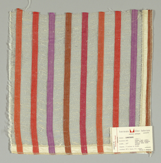 Vertical bands of plain weave in orange, red, violet, brown and magenta are joined together by long off-white weft floats. Bands give a stripe effect. Number 425.
