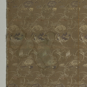 Length of dull greenish-brown compound silk with medium-sized allover pattern of flowering grasses and pieces of brocade in golden tan, white and dark brown silk, and tarnished and broken paper gold.