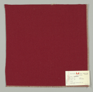 Plain weave with doubled warps and wefts in dark red. Weave structure adds a subtle surface texture. Number 291.