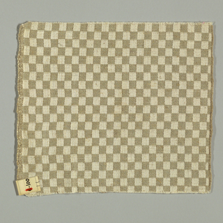 Damask in a beige and white checkerboard pattern.